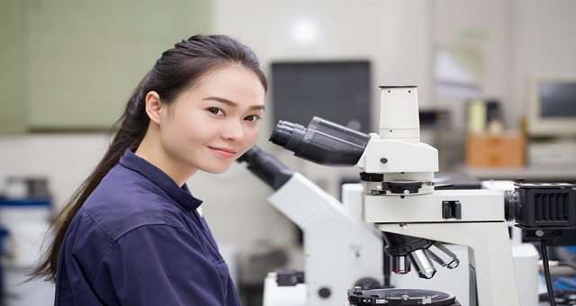 innovation, female scientist looking in microscope in laboratory Laboratory Microscope